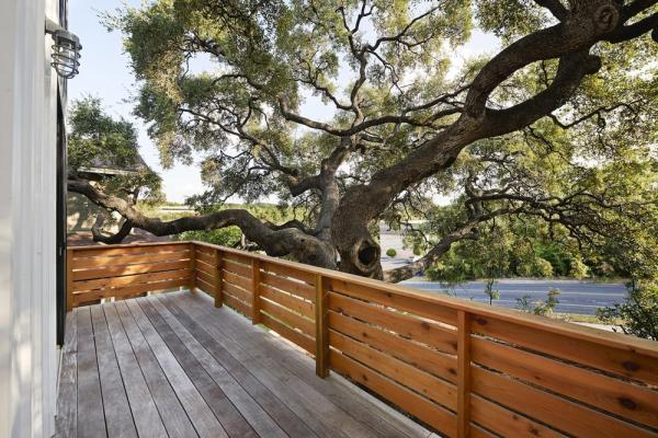 A view from the balcony of House 1 looking onto a tree that was already well-established by the time of the American Revolutionary War. We took great care to preserve the tree's roots and placed each pier of this house's foundation one by one, Image Courtesy © Craig Washburn
