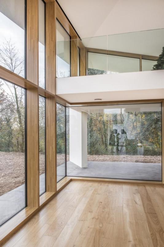 Double-height living area looking towards future garden, Image Courtesy © Alessandro Ruzzier