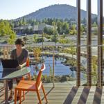 An outdoor deck off the infusion room cantilevers over the healing garden, giving staff and patients a sunny porch on which to relax, Image Courtesy © Pete Eckert