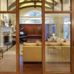 Living Room with piano & soundproof sliding doors, Image Courtesy © Cheryl Fleming Photography