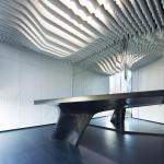 The ceiling is materialized by white Krion louvers, Image Courtesy © Alfonso Calza