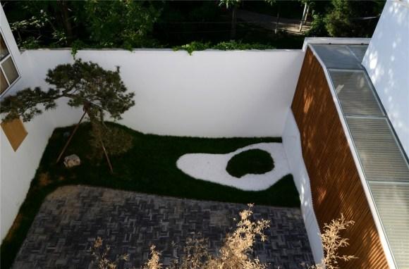 White walls, black bricks, tree shadows, Image Courtesy © He Wei