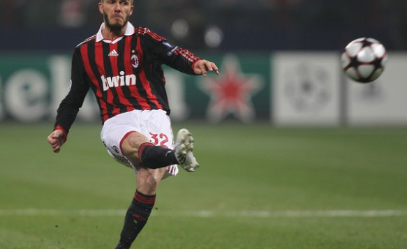 David Beckham of AC Milan takes the free kick which led to their first goal during the UEFA Champions League round of 16 first leg match between AC Milan and Manchester United at Stadio Giuseppe Meazza on February 16, 2010 in Milan, Italy.