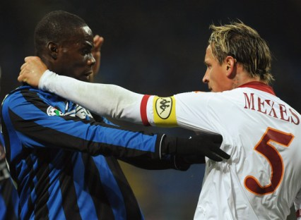 Mario Balotelli of FC Internazionale reacts with Philippe Mexes of AS Roma during the Serie A match between FC Internazionale and AS Roma at Stadio Giuseppe Meazza on November 08, 2009 in Milan, Italy.
