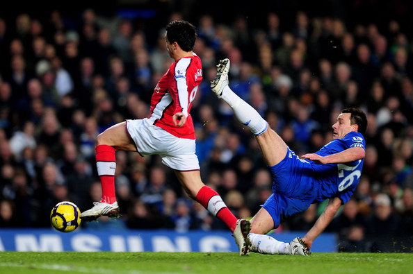John Terry of Chelsea and Samir Nasri of Arsenal stretch for the ball during the Barclays Premier League match between Chelsea and Arsenal at Stamford Bridge on February 7, 2010 in London, England.