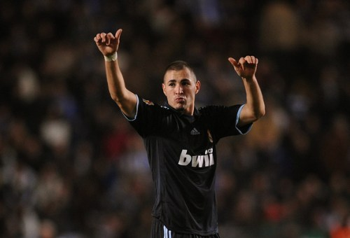 Karim Benzema of Real Madrid celebrates after scoring Real's third goal during the La Liga match between Real Madrid and Deportivo La Coruna at the Riazor Stadium on January 30, 2010 in La Coruna, Spain.