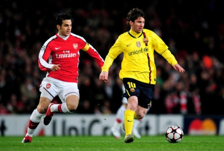 Lionel Messi (R) of Barcelona is pursued by Cesc Fabregas of Arsenal during the UEFA Champions League quarter final first leg match between Arsenal and FC Barcelona at the Emirates Stadium on March 31, 2010 in London, England.