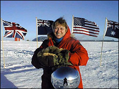 Dr. Jerri Nielsen, a National Science Foundation physician, is shown at the ceremonial South Pole, 1999.
