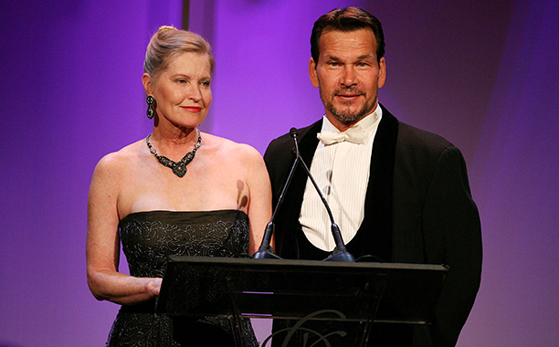 BEVERLY HILLS, CA - FEBRUARY 17: EXCLUSIVE ACCESS. Lisa Niemi (L) and actor Patrick Swayze speak onstage during the 9th annual Costume Designers Guild Awards held at the Beverly Wilshire Hotel on February 17, 2007 in Beverly Hills, California. (Photo by Frazer Harrison/Getty Images for CDG)