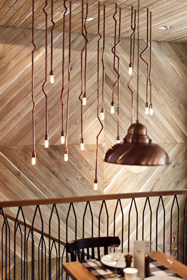 Althaus Restaurant, timber wall panelling, copper chandelier
