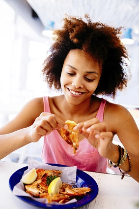 Girl Enjoying seafood in Restaurant