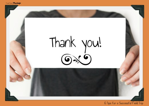 Businessman holding or showing card with thank you text