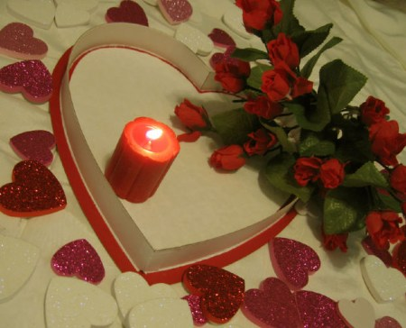 love story of valentines day candle light dinner with rose and heart shape cuts