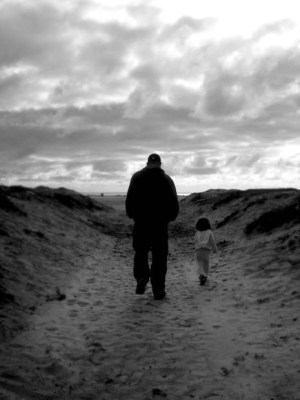 father-daughter-walking-lonepath