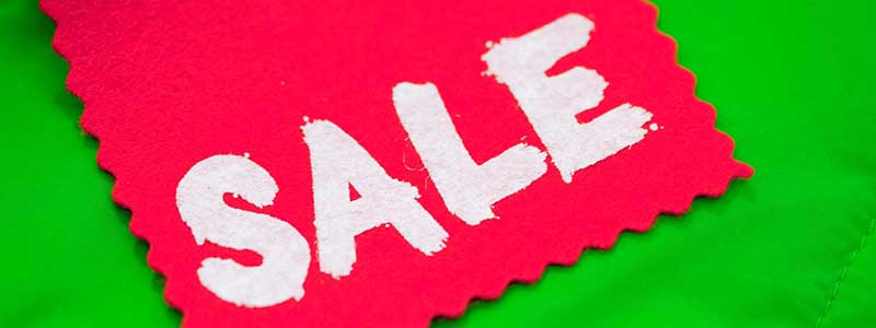 sale sign green red