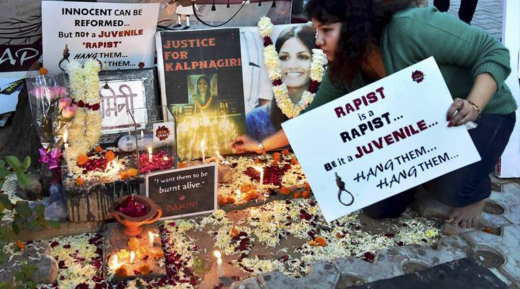 New Delhi : A protester lights candles at a temporary shrine dedicated to the victim of a fatal gang rape of 2012 during a protest against the release of one of the convicts in New Delhi on Monday.  PTI Photo by Kamal Kishore   (PTI12_21_2015_000261A) *** Local Caption ***