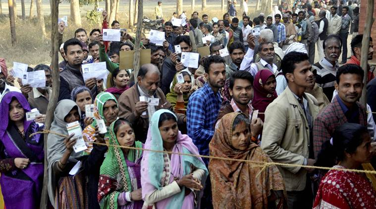 Badaun: Voters queued up to exercise their franchise during second phase of UP Assembly Elections in Badaun on Wednesday. PTI Photo(PTI2_15_2017_000284B)