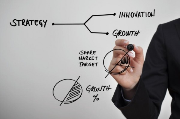 New Trends in Gamification image showing a business person drawing figures for growth and innovation