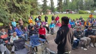 YBC President Cameron Eckert addresses the crowd at Helmut Grünberg's celebration of life at Robert Service Campground. This well-attended event was combined with the 2015 Birdathon post-event gathering.