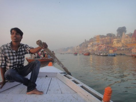 A boy rowing on the River Ganges in Varanasi, India taken during Spring 2011 Semester at Sea voyage by Alexa Rae Johnson via ZaagiTravel.com