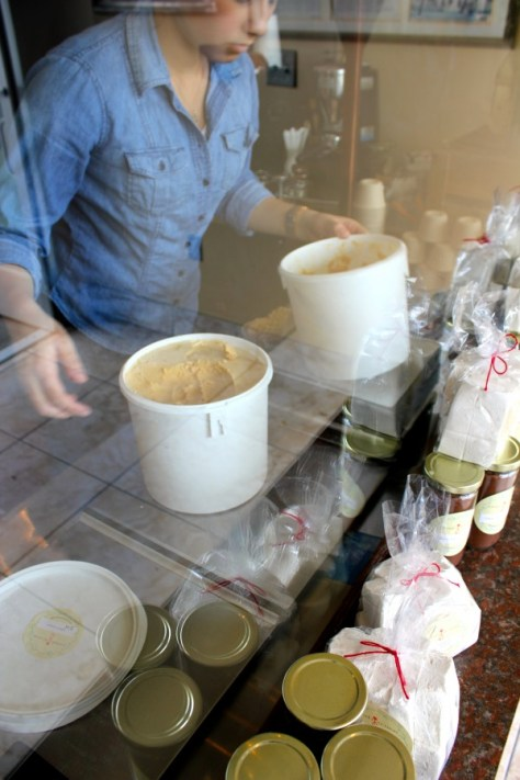 Kira scooping ice cream at Carmela's Ice Cream Shop in Pasadena, Los Angeles, California via ZaagiTravel.com