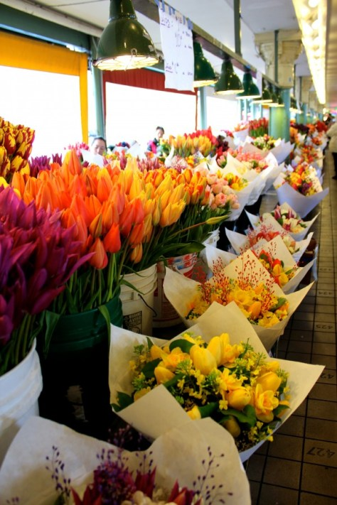Flowers being sold in Pike Place Market in Seattle, Washington, United States via ZaagiTravel.com