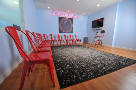 ZBS Space Room. Acting classroom.  Fun and creative space, with neon signage.  SmartTV and high def camera.  Suitable for 10-12 students.