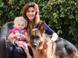 german shepherd dog and family