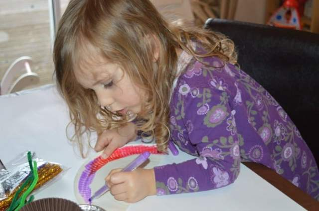 child doing crafts