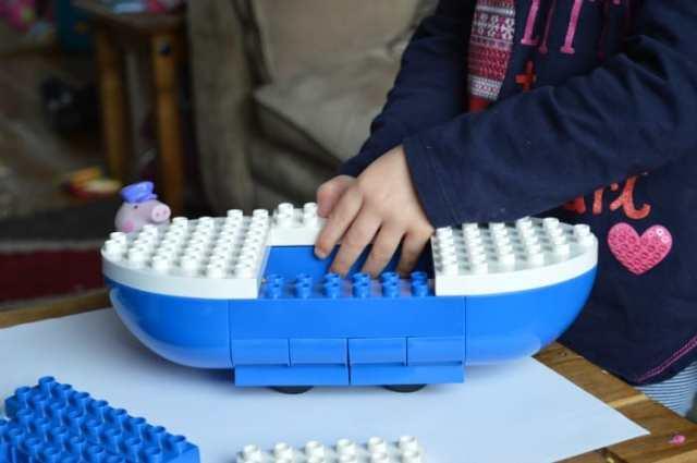 girl making peppa pig boat