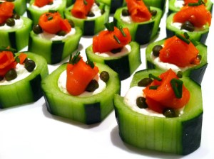 Smoked salmon in cucumber cups with creme fraîche, capers, and chives.