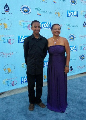 Judith Falloon-Reid on the Blue Carpet with her grandson, Ajani, at the Caribbean Heritage Awards Gala