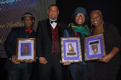 Jamaica's Ambassador to the United States, His Excellency Ralph Thomas is flanked by Jamaican recipients of the 2015 Caribbean Heritage Awards (l-r) is Michael Thompson recipient of the Outstanding Community Service Award, Luminary awardee, international Reggae Artist Maxi Priest and recipient of the Forerunner Award Beverly East. (Photo Credit Derrick Scott)