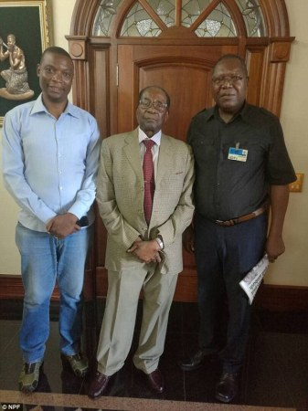 Fears Mugabe could return to power after he poses for a photo with the leader of the opposition