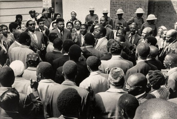 Nelson Mandela and friends sing 'Nikosi Sikelel I Afrika' at the end of their trial for treason in South Africa.