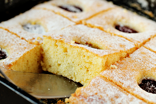 plum cake recipe with step by step picture tutorial, remove from the oven and let cool, then dust with a little confectioners' sugar and cut into squares