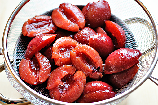 plum cake recipe with step by step picture tutorial, cut the plums into halves, or if you are using canned plum, drain them
