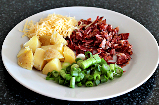 Loaded potato soup step by step recipe with pictures. Prepare the fixings: cook the bacon and cut/crumble it. Shred the cheese (1/4 cup - 25 grams). Cut the reserved potatoes into small cubes and cut the green onions.