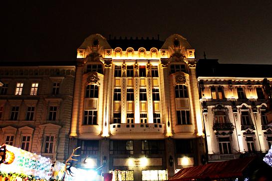 Christmas market lit building at night