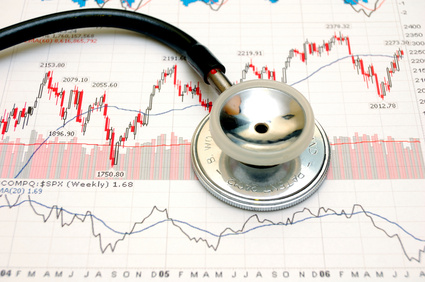 Stethoscope and stock chart - market analysis.
