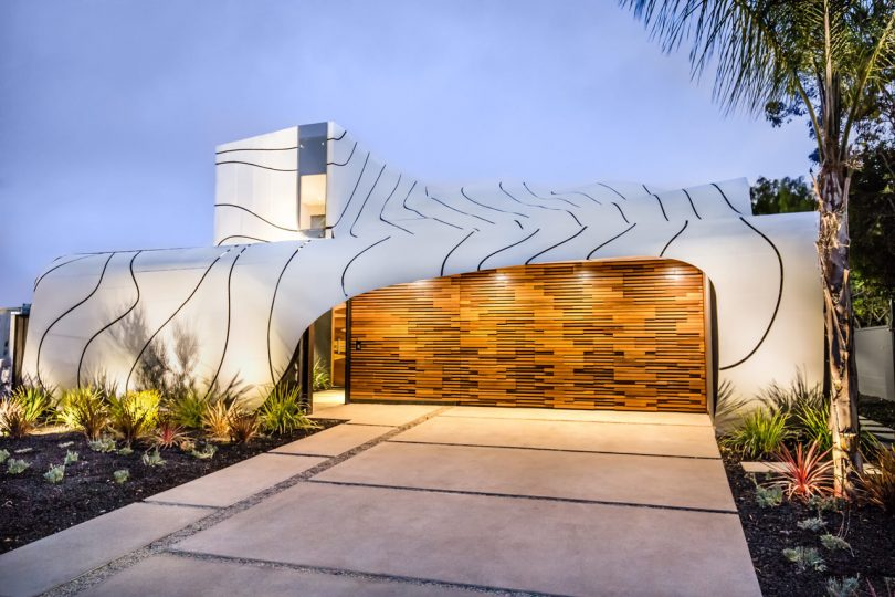 A House with a Massive, Undulating, Wave-Like Exterior