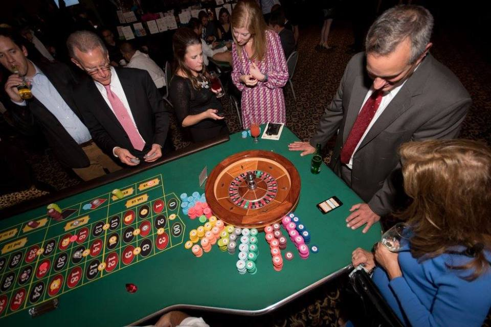 People playing roulette.