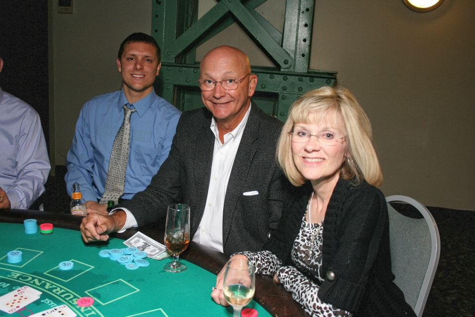 People sitting at a card table.