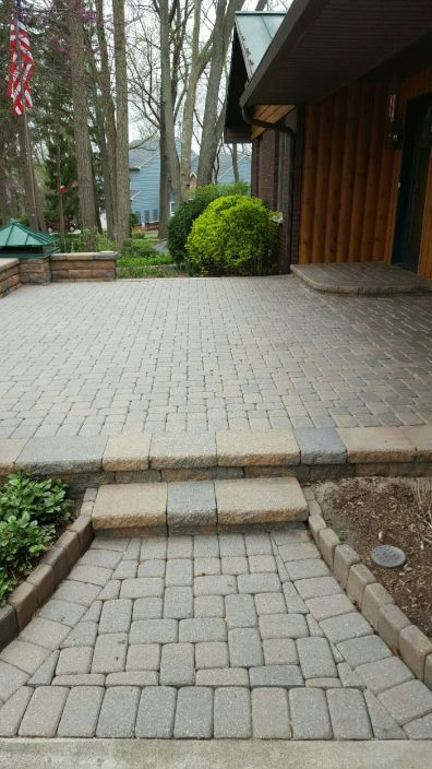 Before Photo of Stone Walk Way with Step Up