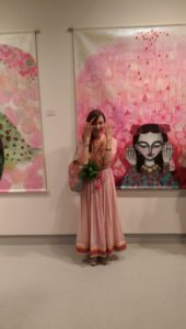 This is me - Rima Fujita posing in front of her painting