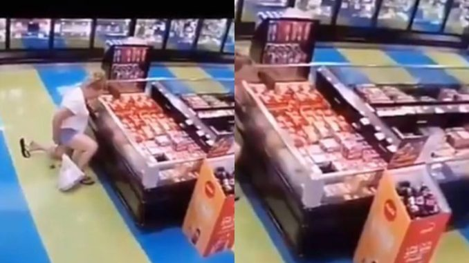 Watch the moment a woman poo-ed on the floor in a supermarket (Video)