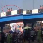 Crowd Gather To Watch 3 Young Men Clad In Only Red Wrapper Bathing On A Bridge In Broad Daylight (Video)
