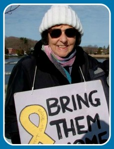 Estelle Margolis earlier this winter. Every Saturday, she is part of an anti-war vigil on the Post Road bridge.