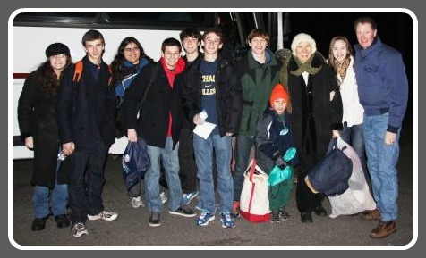 The Mathias family (far right) with young Westporters, at the exit 18 park-and-ride before boarding the midnight bus to Washington.