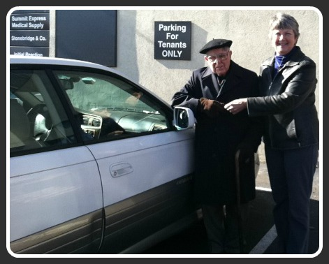 Stuart Bernard, Nancy  McCormick, and the newly donated Subaru Legacy.